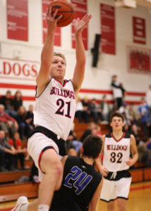 Cole Harko, with a half-a-second left in the second half, shoots a basket bringing the score to Romeo 39, Eisenhower 19. After Friday's victory, the boys record is 2-0. (Photo by Mike Nicley)
