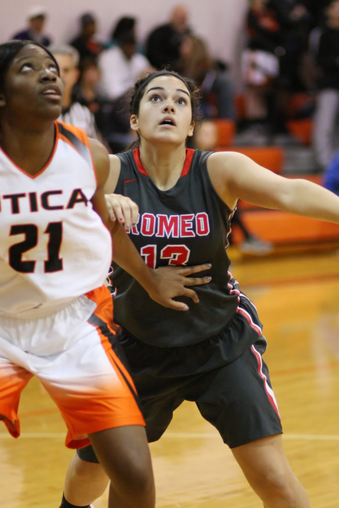 Rachelle Baumann, #13, eyes ball at the rim during a one-on-one free throw by Romeo. (Photo by Mike Nicley)