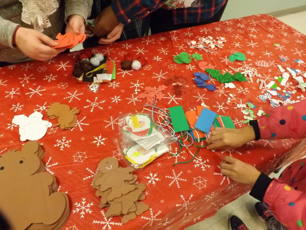 Children make arts and crafts during Santa's visit to Washington on Friday. (Photo by Stacy Sobotka)