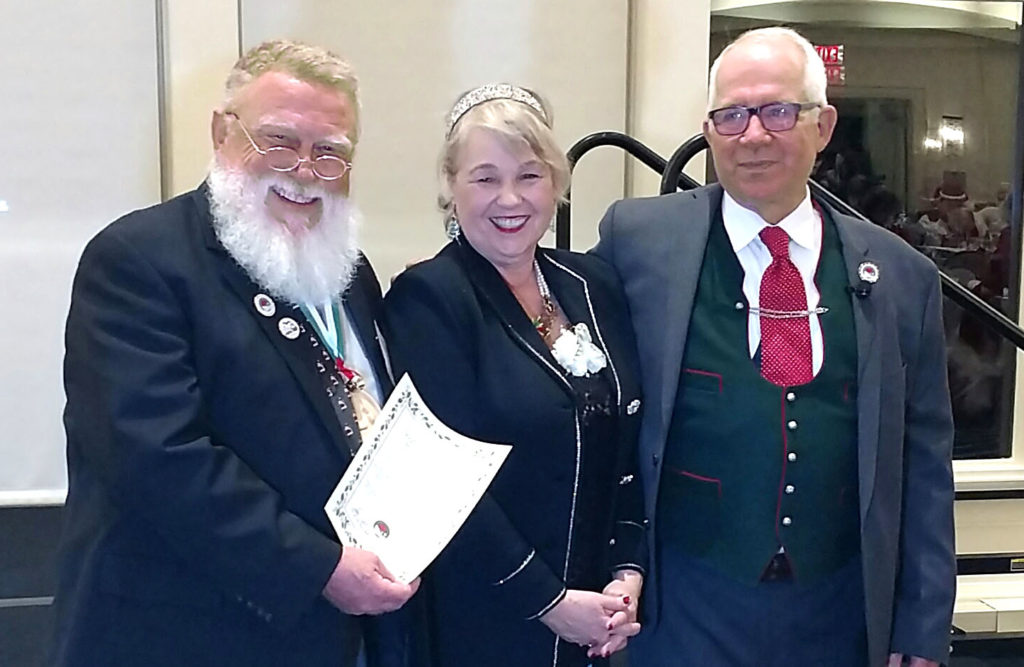 Pictured from left to right are graduate David Symes, Holly Valent, and Tom Valent, Dean of the Charles W. Howard Santa School in Midland. (Photo courtesy of David Symes)