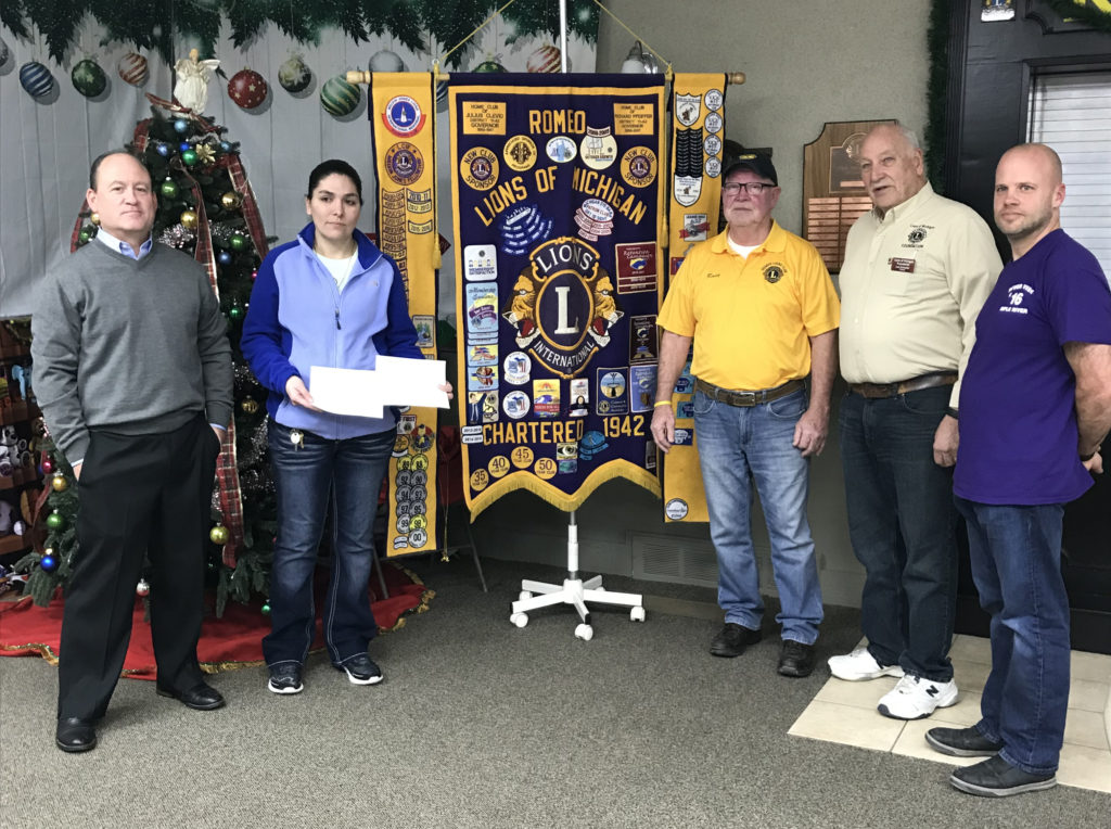 The Romeo Lions Club made a presentation at the club house and awarded both families with $1500.00 each. Pictured from left to right are Scott Luther, JoJo Rodriguez, who was one of the fire victims, Rudy Murphy, Leo Schaefer and Matt Dreyer. Not shown in the picture is Victoria Flores, who also lost her home in the fire. (Photo courtesy of the Romeo Lions Club)